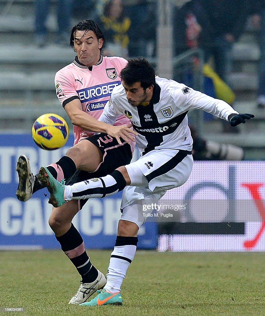 Nicola Sansone (R) of Parma is challenged by Salvatore Aronica of Palermo during the Serie A match between Parma FC and US Citta di Palermo at Stadio Ennio Tardini on January 6, 2013 in Parma, Italy.