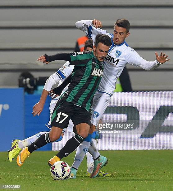 Nicola Sansone of Sasuolo and Vecino of Empoli in action during the Serie A match between US Sassuolo Calcio and Empoli FC at Mapei Stadium on...
