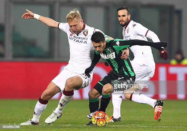 Nicola Sansone of US Sassuolo Calcio competes for the ball with Kamil Glik of Torino FC during the Serie A match betweeen US Sassuolo Calcio and...