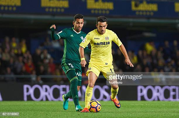 Nicola Sansone of Villarreal CF and Petros of Real Betis in action during the Spanish League 2016/17 match between Villarreal CF and Real Betis at El...