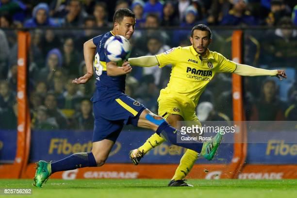 Nicola Sansone of Villarreal CF fights for the ball with Leonardo Jara of Boca Juniors during the international friendly match between Boca Juniors...