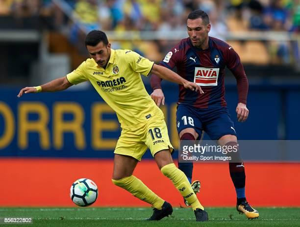 Nicola Sansone of Villarreal competes for the ball with Anaitz Arbilla of Eibar during the La Liga match between Villarreal and Eibar at Estadio De...