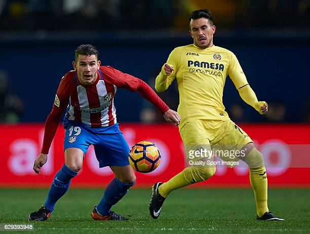Nicola Sansone of Villarreal competes for the ball with Lucas Hernandez Pi of Atletico de Madrid during the La Liga match between Villarreal CF and...