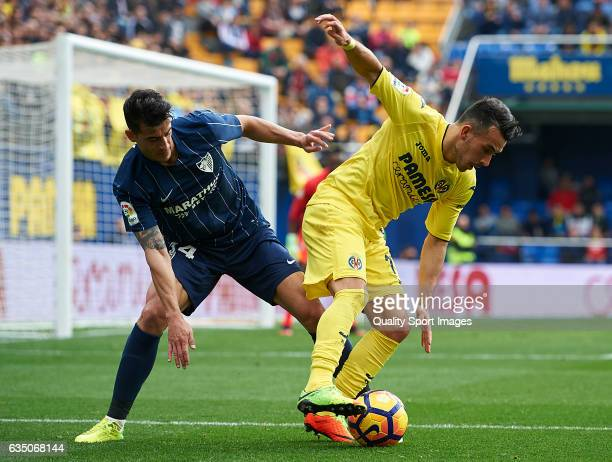 Nicola Sansone of Villarreal competes for the ball with Luis Hernandez of Malaga during the La Liga match between Villarreal CF and Malaga CF at...