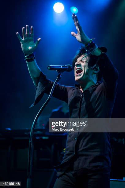 Nicola Sirkis of Indochone performs on stage at Shepherds Bush Empire on July 14 2014 in London United Kingdom