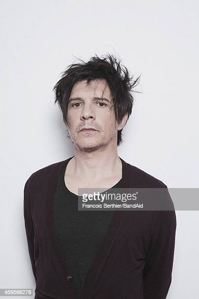 Nicola Sirkis poses for a portrait session during the Band Aid 30 'Noel est la' single recording at Studio Grande Armee on November 23 2014 in Paris...