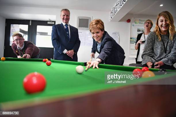 Nicola Sturgeon and Pete Wishart the SNP candidate for Perth and North Perthshire play pool at Strathmore Centre for Youth Development on May 22 2017...