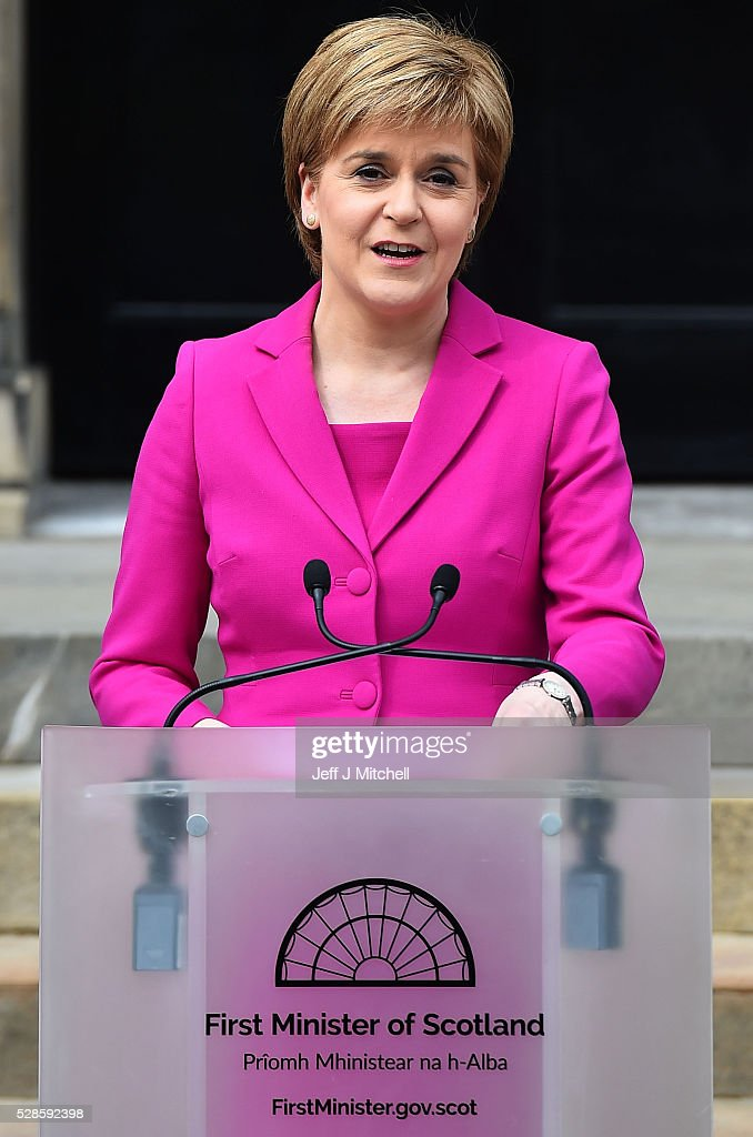 Spectators watch as <a gi-track='captionPersonalityLinkClicked' href=/galleries/search?phrase=Nicola+Sturgeon&family=editorial&specificpeople=2582617 ng-click='$event.stopPropagation()'>Nicola Sturgeon</a> announces she won't form a coalition but that her government will be inclusive at Holyrood on May 06, 2016 in Edinburgh, Scotland. <a gi-track='captionPersonalityLinkClicked' href=/galleries/search?phrase=Nicola+Sturgeon&family=editorial&specificpeople=2582617 ng-click='$event.stopPropagation()'>Nicola Sturgeon</a>, leading the Scottish National Party, won a historic third term at the Holyrood elections overnight. The SNP will likely form a minority government after failing to win a majority taking 63 seats out of a possible 129. The Conservative Party became the second largest party pushing Labour into third place.