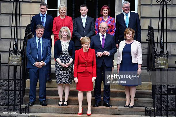 Nicola Sturgeon First Minister of Scotland laughs as she stands on the steps of Bute House with her new cabinet Michael Matheson Justice Secretary...