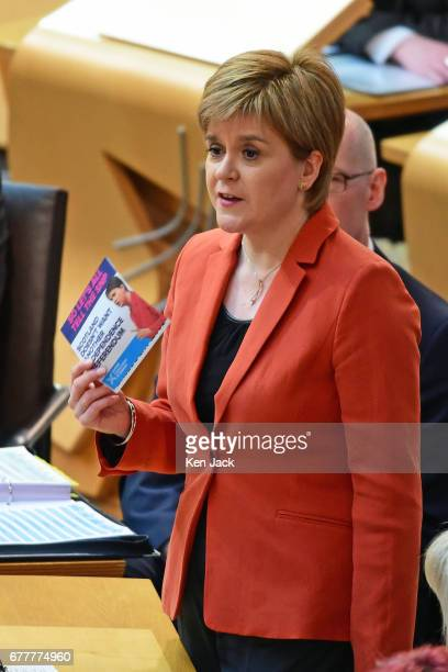 Nicola Sturgeon holds up a Conservative election leaflet at First Minister's Questions in the Scottish Parliament claiming it said nothing about...