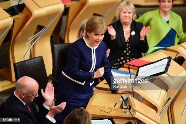 Nicola Sturgeon is applauded by front bench colleagues at First Minister's Questions in the Scottish Parliament on April 20 2017 in Edinburgh Scotland