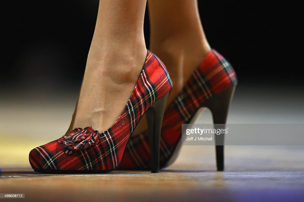 Nicola Sturgeon, wears tartan shoes as she delivers her first key note speech as SNP party leader at the party's annual conference on November 15, 2014 in Perth, Scotland. Nicola Sturgeon formally took over the leadership of the SNP from Alex Salmond yesterday, during her speech she urged voters to leave Labour in next May's UK election.