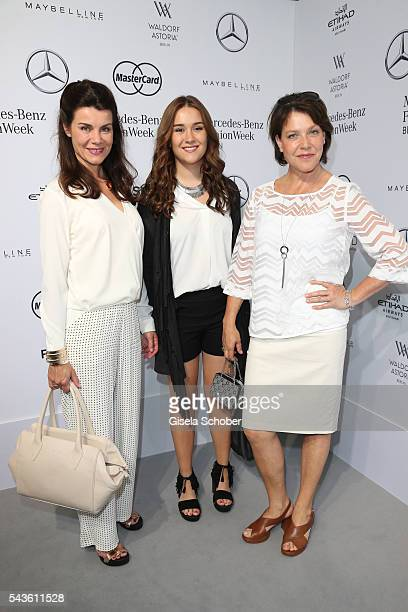 Nicola Tiggeler her daughter Tiffany and Janina Hartwig attend the Minx by Eva Lutz show during the MercedesBenz Fashion Week Berlin Spring/Summer...