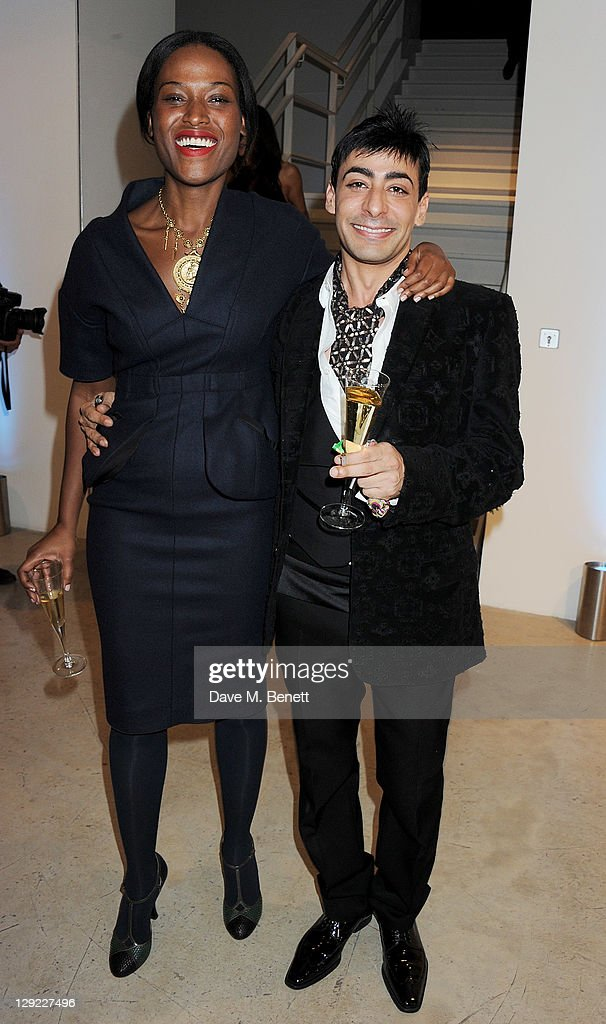 Nicola Vassell (L) and Raqib Shaw attend 'Arts For Human Rights', the inaugural Bianca Jagger Human Rights Foundation Gala supported by Swarovski, at Phillips de Pury And Company on October 14, 2011 in London, England.