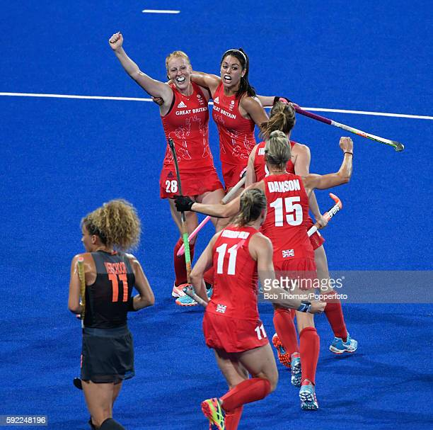 Nicola White celebrates after scoring Great Britain's third goal during the Women's hockey Gold medal match between The Netherlands and Great Britain...