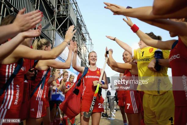 Nicola White of England is congratulated on reaching 100 caps by her teammates after day 2 of the FIH Hockey World League Semi Finals Pool A match...