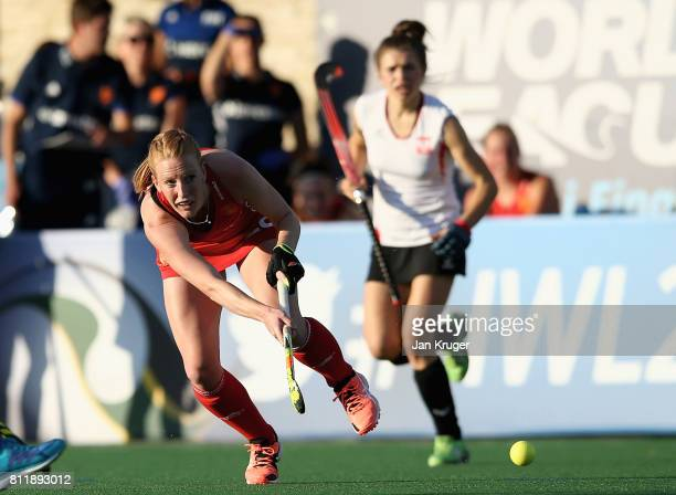 Nicola White of England passes the ball during day 2 of the FIH Hockey World League Semi Finals Pool A match between England and Poland at Wits...