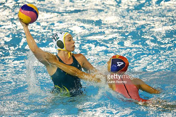 Nicola Zagame of Australia controls the ball against Roser Tarrago of Spain during the Women's Water Polo Gold Medal Match between Australia and...