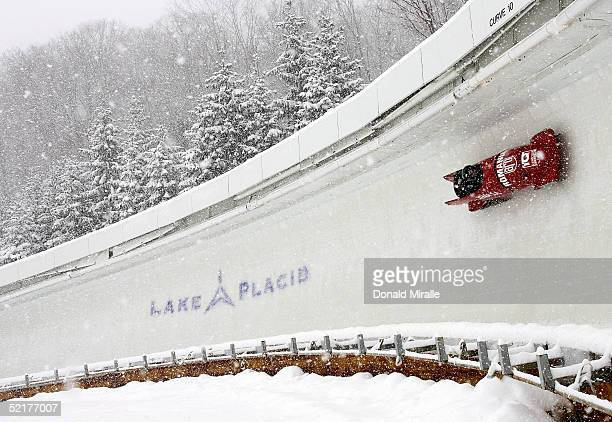 Nicolae Istrate and Vasile Bolozan pilot the Romania II bobsled in heavy snow during training for the Bobsled Skeleton World Cup February 10 2005 at...