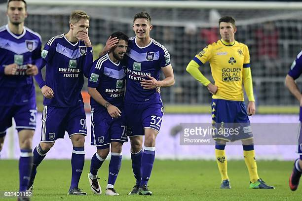 Nicolae Stanciu midfielder of RSC Anderlecht celebrates scoring a goal with teammates Lukasz Teodorczyk forward of RSC Anderlecht and Leander...