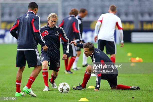 Nicolai Boilesen Christian Poulsen and Joel Veltman of Amsterdam attend the training session of Ajax Amsterdam at SignalIduna Park in Dortmund...