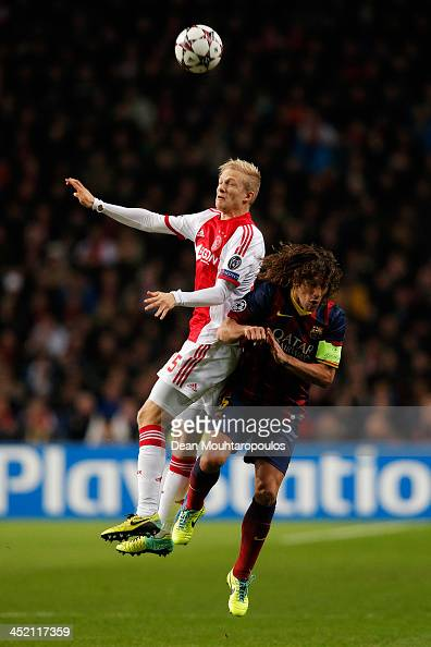 Nicolai Boilesen of Ajax and Carles Puyol of Barcelona battle for the header during the UEFA Champions League Group H match between Ajax Amsterdam...
