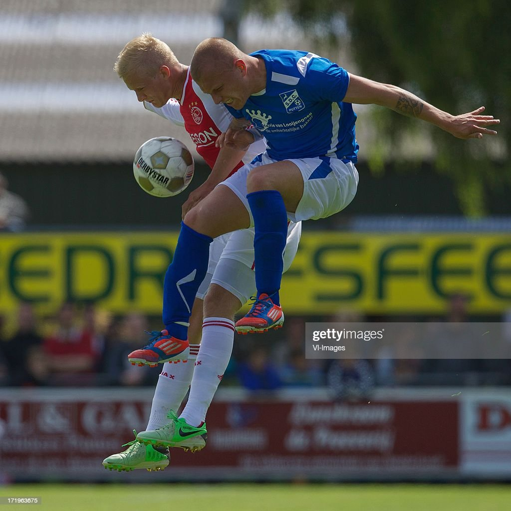 Nicolai Boilesen of Ajax, Rob Buter of SDC Putten during the pre season friendly match between SDC Putten and Ajax on June 29, 2013 in Putten, The Netherlands.