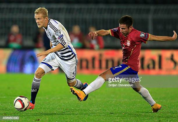 Nicolai Boilesen of Denmark in action against Zoran Tosic of Serbia during the Euro 2016 group I qualifying football match between Serbia and Denmark...