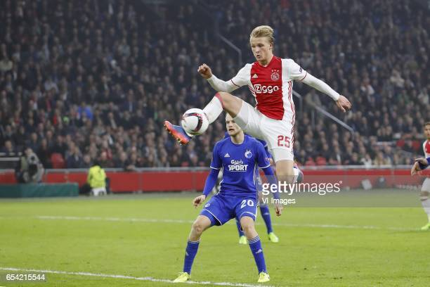 Nicolai Boilesen of FC Copenhagen Kasper Dolberg of Ajaxduring the UEFA Europa League round of 32 match between Ajax Amsterdam and FC Copenhagen at...