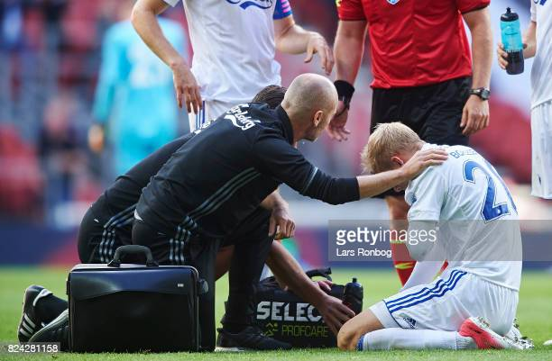Nicolai Boilesen of FC Copenhagen sits injured on the pitch during the Danish Alka Superliga match between FC Copenhagen and Hobro IK at Telia Parken...
