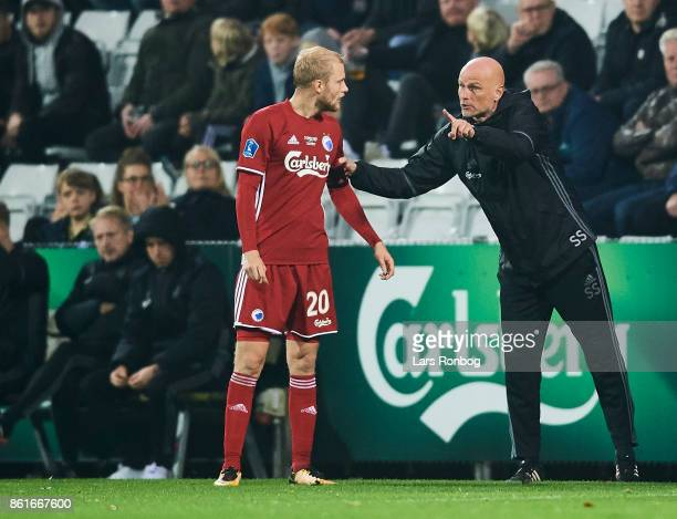 Nicolai Boilesen of FC Copenhagen speaks to Stale Solbakken head coach of FC Copenhagen during the Danish Alka Superliga match between OB Odense and...