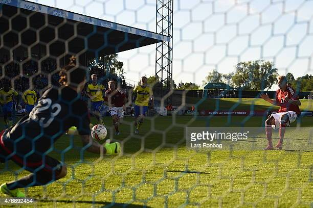 Nicolai BrockMadsen of Denmark scores the 21 goal against goalkeeper Andreas Linde of Sweden the U21 International friendly match between Denmark and...