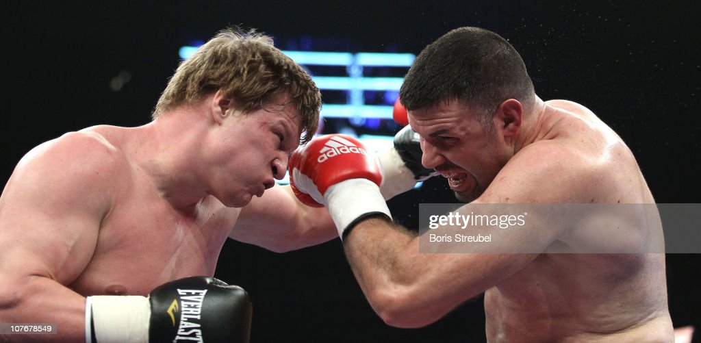Nicolai Firtha (R) of USA and <a gi-track='captionPersonalityLinkClicked' href=/galleries/search?phrase=Alexander+Povetkin&family=editorial&specificpeople=2351769 ng-click='$event.stopPropagation()'>Alexander Povetkin</a> (L) of Russia exchange punches during their Heavyweight fight at Max-Schmeling Hall on December 18, 2010 in Berlin, Germany.