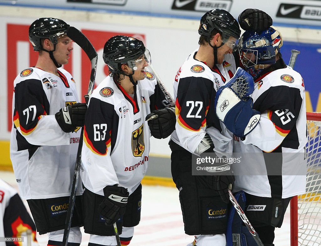Nicolai Goc Andre Reiss Michael Bakos and goalie Youri Ziffzer of Germany celebrate the 30 victory after the International Friendly match between...