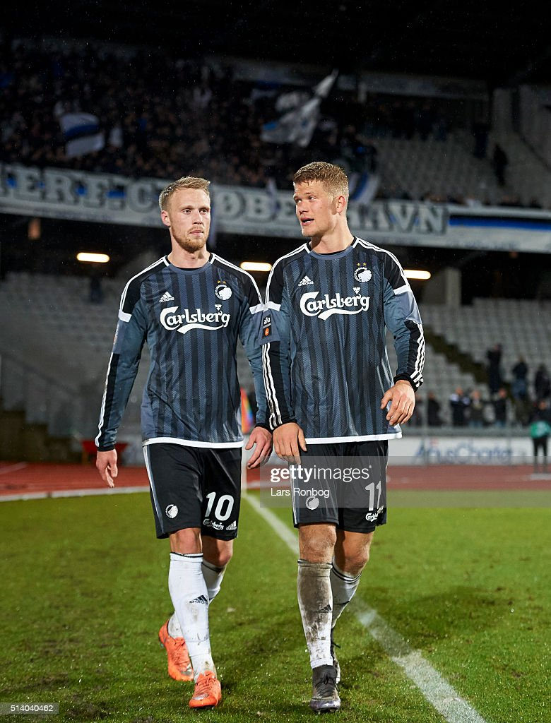 Nicolai Jorgensen and <a gi-track='captionPersonalityLinkClicked' href=/galleries/search?phrase=Andreas+Cornelius&family=editorial&specificpeople=8617821 ng-click='$event.stopPropagation()'>Andreas Cornelius</a> of FC Copenhagen walks off the pitch with the fans in the background after the Danish Alka Superliga match between AGF Aarhus and FC Copenhagen at Ceres Park on March 6, 2016 in Aarhus, Denmark.