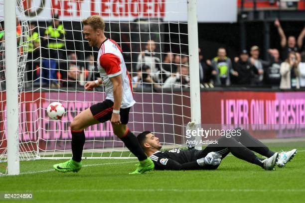 ROTTERDAM NETHERLANDS JULY Nicolai Jorgensen from Feyenoord scores a goal while Geronimo Rulli from Real Sociedad reacts during the friendly match...