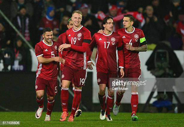 Nicolai Jorgensen of Denmark celebrates with his team mates after scoring his side's second goal during the International Friendly match between...