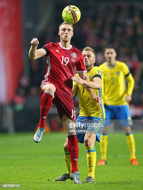Nicolai Jorgensen of Denmark controls the ball ahead of Sebastian Larsson of Sweden during the UEFA EURO 2016 Qualifier PlayOff Second Leg match...