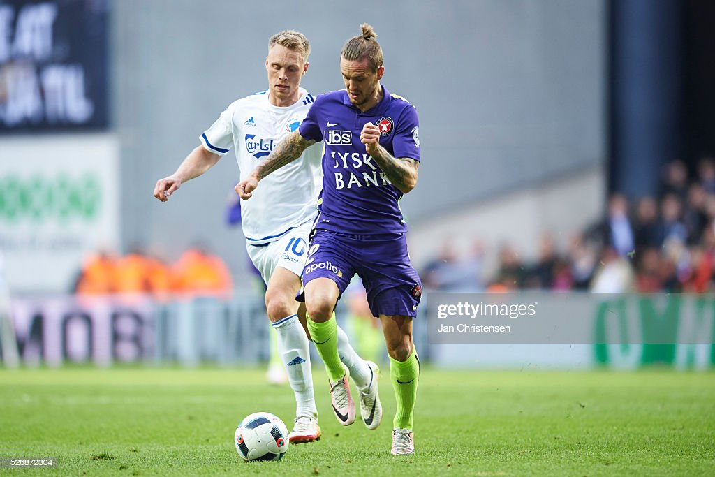 Nicolai Jorgensen of FC Copenhagen and Kian Hansen of FC Midtjylland compete for the ball during the Danish Alka Superliga match between FC Copenhagen and FC Midtjylland at Telia Parken Stadium on May 01, 2016 in Copenhagen, Denmark.