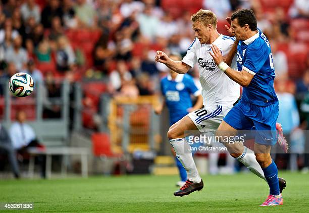 Nicolai Jorgensen of FC Copenhagen compete for the ball during UEFA Champions League Third Qualifying Round Second Leg between FC Copenhagen and...