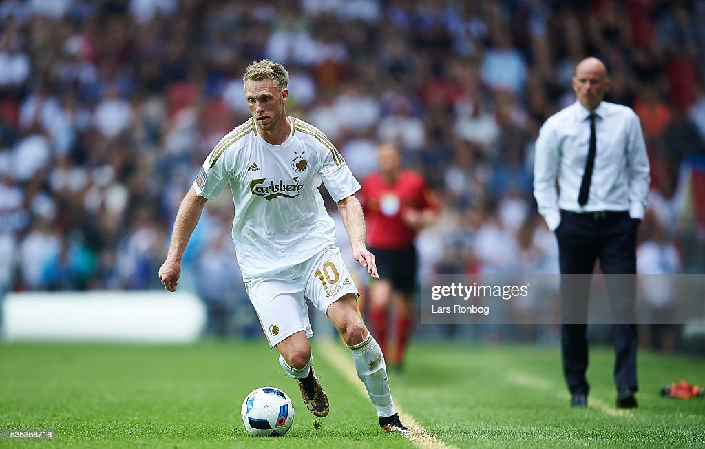 Nicolai Jorgensen of FC Copenhagen controls the ball while <a gi-track='captionPersonalityLinkClicked' href=/galleries/search?phrase=Stale+Solbakken&family=editorial&specificpeople=2726325 ng-click='$event.stopPropagation()'>Stale Solbakken</a>, head coach of FC Copenhagen looks on in the background during the Danish Alka Superliga match between FC Copenhagen and AGF Aarhus at Telia Parken Stadium on May 29, 2016 in Copenhagen, Denmark.