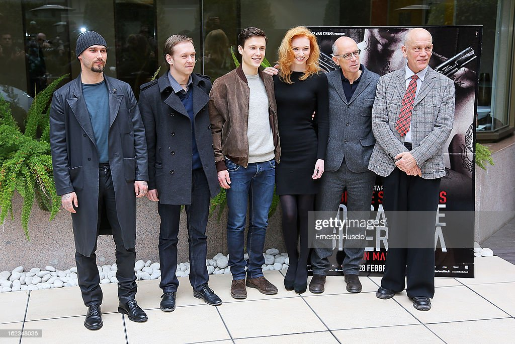 Nicolai Lilin,Vilius Tumalavicius, Arnas Fedaravicius, Eleanor Tomlinson, Gabriele Salvatores and John Malkovich attend the 'Educazione Siberiana' photocall at Hotel Visconti Palace on February 22, 2013 in Rome, Italy.