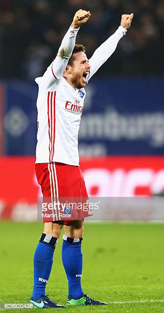 Nicolai Müller of Hamburg celebrates the first goal scored by Filip Kostic during the Bundesliga match between Hamburger SV and FC Augsburg at...