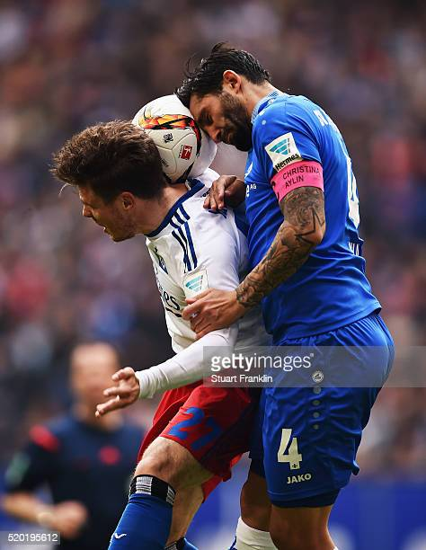 Nicolai Müller of Hamburg is challenged by Aytac Sulu of Darmstadt during the Bundesliga match between Hamburger SV and SV Darmstadt 98 at...