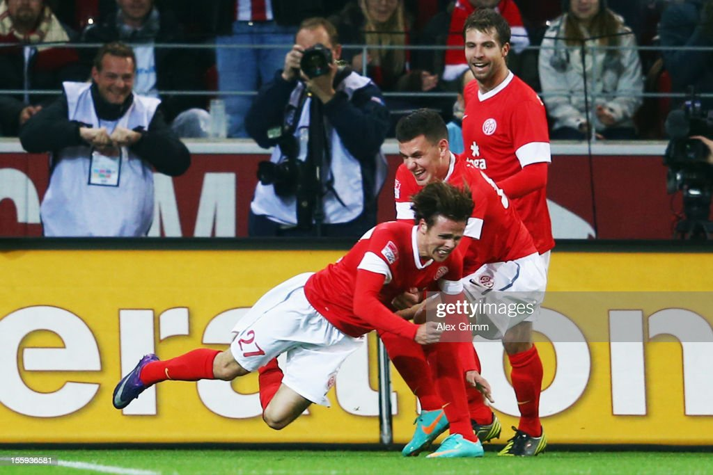 <a gi-track='captionPersonalityLinkClicked' href=/galleries/search?phrase=Nicolai+Mueller&family=editorial&specificpeople=2344337 ng-click='$event.stopPropagation()'>Nicolai Mueller</a> (front) celebrates his team's first goal with team mates <a gi-track='captionPersonalityLinkClicked' href=/galleries/search?phrase=Adam+Szalai&family=editorial&specificpeople=2344504 ng-click='$event.stopPropagation()'>Adam Szalai</a> and <a gi-track='captionPersonalityLinkClicked' href=/galleries/search?phrase=Andreas+Ivanschitz&family=editorial&specificpeople=2140350 ng-click='$event.stopPropagation()'>Andreas Ivanschitz</a> during the Bundesliga match between 1. FSV Mainz 05 and 1. FC Nuernberg at Coface Arena on November 9, 2012 in Mainz, Germany.