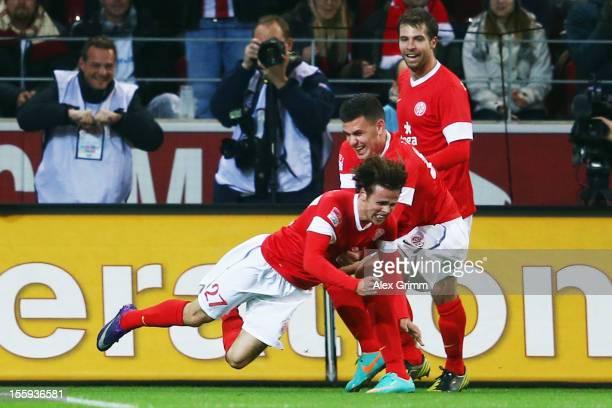 Nicolai Mueller celebrates his team's first goal with team mates Adam Szalai and Andreas Ivanschitz during the Bundesliga match between 1 FSV Mainz...