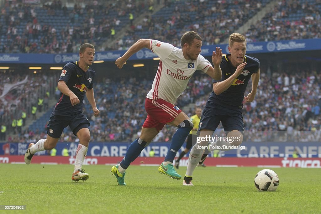 Nicolai Mueller of Hamburg and Marcel Halstenberg of Leipzig compete for the ball during the Bundesliga match between Hamburger SV and RB Leipzig at Volksparkstadion on September 17, 2016 in Hamburg, Germany.