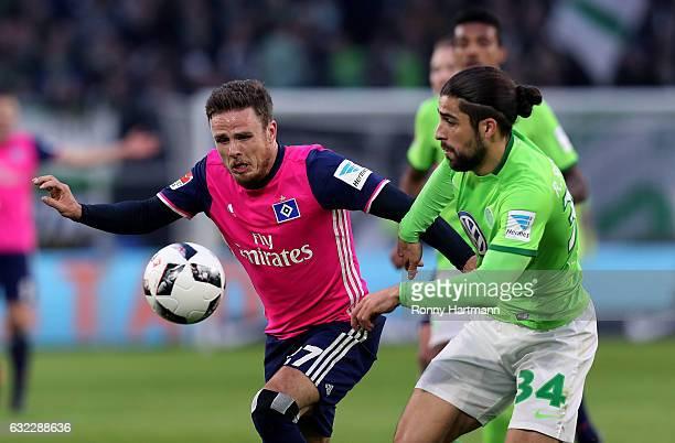 Nicolai Mueller of Hamburg and Ricardo Rodriguez of Wolfsburg vie during the Bundesliga match between VfL Wolfsburg and Hamburger SV at Volkswagen...