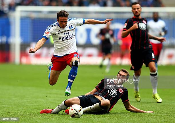 Nicolai Mueller of Hamburg and Stefan Reinartz of Frankfurt battle for the ball during the Bundesliga match between Hamburger SV and Eintracht...