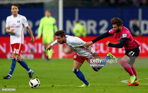 Nicolai Mueller of Hamburg is challenged by Marvin Plattenhardt of Berlin during the Bundesliga match between Hamburger SV and Hertha BSC at...